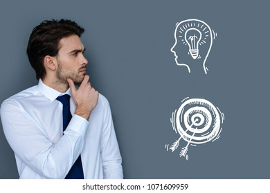 Interesting idea. Clever young professional lawyer thoughtfully looking into the distance while getting an interesting idea