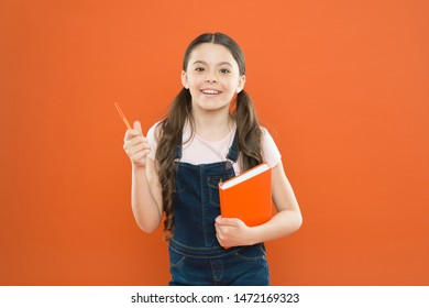 Interesting literature. Development and education. Child care and happy childhood. Study at school. First day at school. Ready for first lesson. September is here. Back to school. Child hold book.