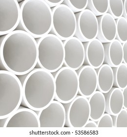 Interesting perspective of new white PVC pipes stacked on a pallet