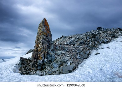 Interesting rock formations and ringneck penguins at Whaler's Village in Antarctica, an abandoned whaling outpost