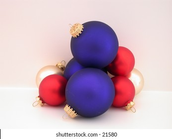 Interesting stack of Red, White and Blue Christmas ornaments