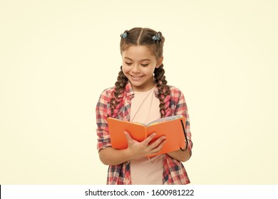 Interesting story. Achieve knowledge. Education concept. Cute small child holding book. Adorable little girl with school exercise book. Preparing activity book writing. Reading skills. Study language.
