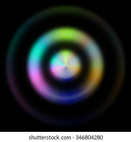 Interesting and unusual illustration of 3 blurred concentric circles - 2 inner in rainbow colors and the outer one almost not visible; on black background