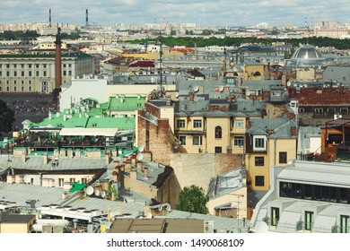 Interesting view to famous roofs of Saint Petersburg, General Staff Building, Alexandrian Column, Palace Square under blue sky with clouds. Outdoor shot