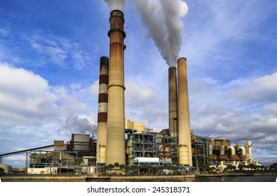 An interesting view of smoke stack at a power plant.