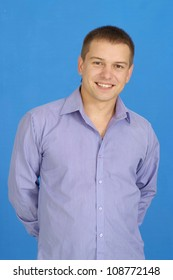 Interesting young guy with short hair  on a blue background