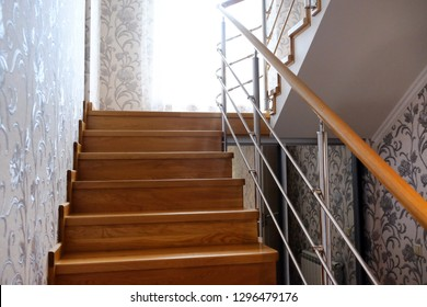 Interfloor stairs from the valuable breeds of wood for the cottage. Wooden staircase to the second floor. Modern wooden staircase with brown wooden railing