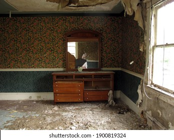 Interior of an abandoned and neglected home. Natural light.