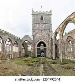 The interior of the abandoned rumbled Saint Peter's Church in the Castle Park, with pointed arch windows and bell tower, in Bristol, United Kingdom