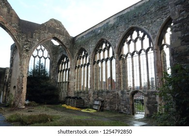 The interior of the abandoned rumbled Saint Peter's Church in the Castle Park, with pointed arch Gothic windows, in Bristol, United Kingdom