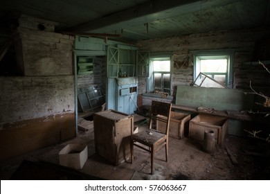 Interior of abandoned traditional log hut in Russia