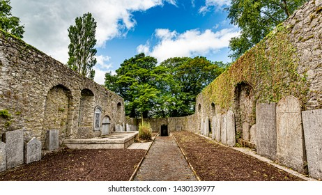 Interior of Abbey Graveyard with a path in the middle and tombstones in the town of Athlone, wonderful spring day in the county of Westmeath, Ireland