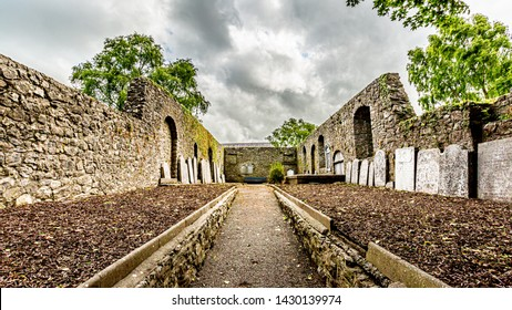 Interior of Abbey Graveyard with a path and tombstones in Athlone town, wonderful cloudy spring day in County Westmeath, Ireland