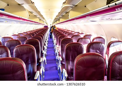 Interior of an airplane with empty seats. Blur concept. Selective Focus.