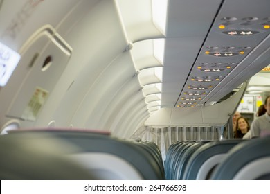 Interior of airplane with passengers boarding