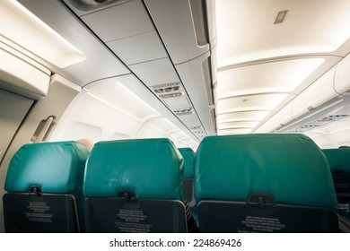 Interior of airplane with row of seats