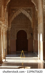 The interior of Alhambra boasts a range of arches, patterns, inscriptions, and coloured tiles. The Alhambra overlooks the city of Granada in Spain.