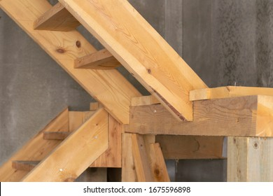 Interior of apartment construction and wooden stairs to the second floor. side view close-up