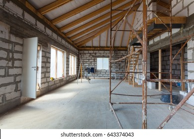 Interior of apartment with ladders during under renovation, remodeling and construction (preparing to plaster)