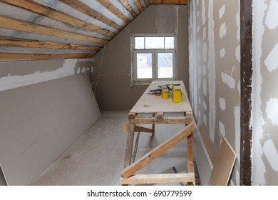 Interior of  apartment  and materials (home-made scaffold, tools, level) during on the renovation, overhaul and construction ( remodeling and repairing wall  from  drywall and inside roof warming)