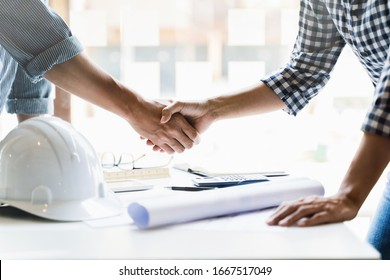 Interior Architect hand shaking with contract engineering.
