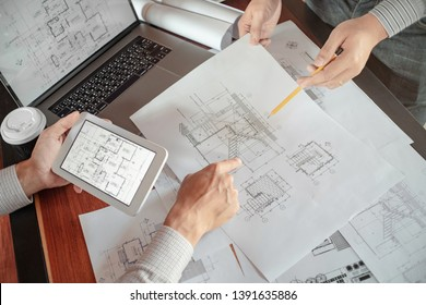 Interior architecture discussing with blueprint, Engineering Concept.