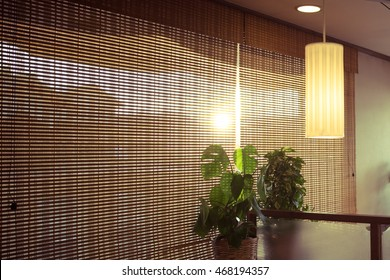 INTERIOR WITH BAMBOO CURTAINS AND LAMP BACKGROUND