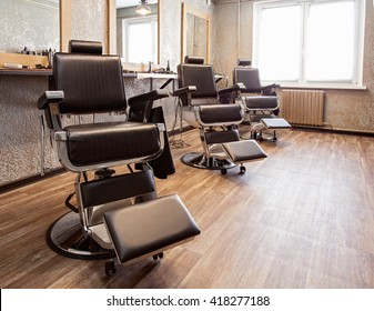 Interior of a barbershop, armchairs for clients