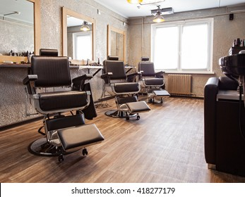 Interior of a barbershop with client's armchairs
