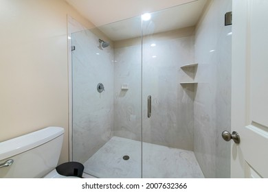 Interior of a bathroom with frameless shower stall