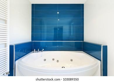 interior of bathroom in modern house, hot tub
