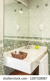 Interior of a bathroom with mosaic in the walls.