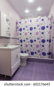 The interior of the bathroom, room with dressing room, shower curtain closed
