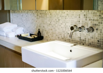 Interior of bathroom with sink basin faucet.