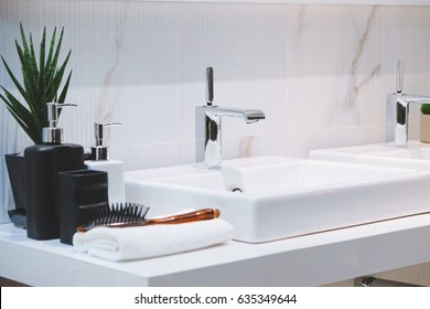 Interior of bathroom with sink basin faucet. Modern design of bathroom