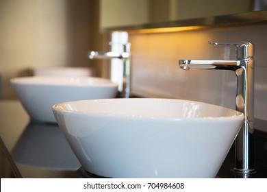 Interior of bathroom with sink basin faucet. Modern design of bathroom