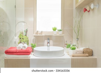 Interior of bathroom with washbasin faucet and white towel.Modern design of bathroom.