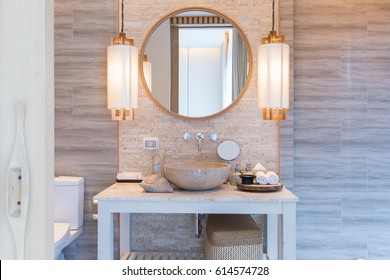 Interior of bathroom with washbasin faucet and white towel.Modern design of bathroom