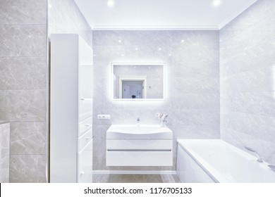 The interior of the bathroom in white modern house.