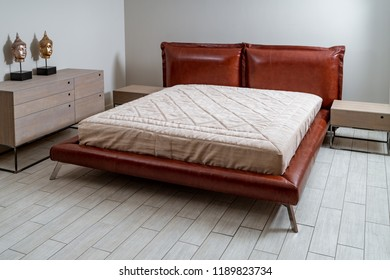 The interior is a beautiful brown bed with a white blanket