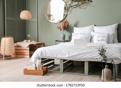 Interior of beautiful modern bedroom with spring flowers