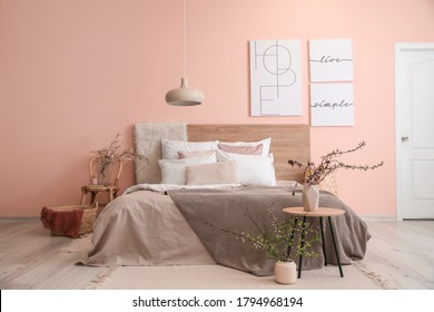 Interior of beautiful modern bedroom with spring flowers - Shutterstock ID 1794968194