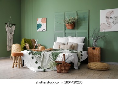 Interior of beautiful modern bedroom with spring flowers - Shutterstock ID 1804420285