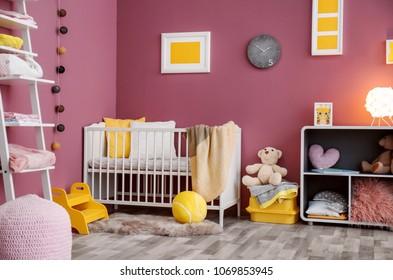 Interior of beautiful modern children's room with crib