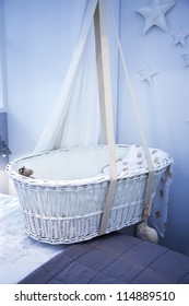 interior of bed room with child basket