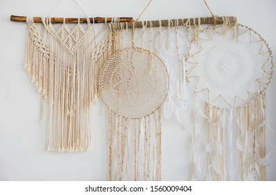 Interior of bedroom with bed in boho style decor macrame. Close up