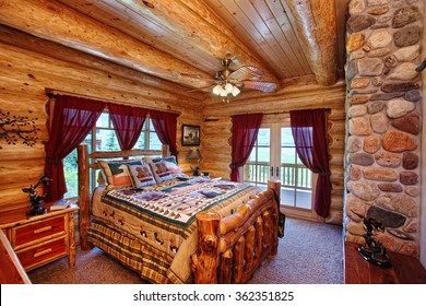 The interior of a bedroom in a modern yet rustic log cabin in the mountains.