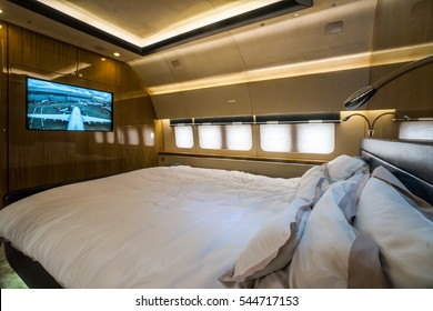 The interior of bedroom of private business jet