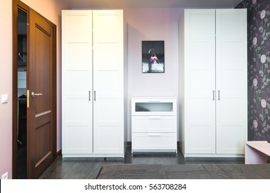 Interior bedrooms with wardrobes and a chest of drawers