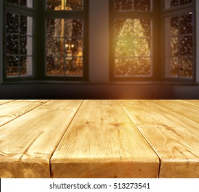 interior with big dark window and wooden old table place